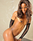 Tina in fishnets. Tiny chocolate hottie Tina posing in fishnets